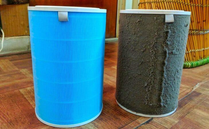 Новый и использованный фильтр к очистителю воздуха от табачного дыма